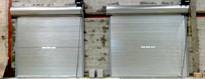 Acme Insulated Rolling Doors with Vision Lites. Motorized with Safety Edges